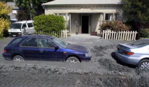 cars stuck in liquefaction outside Canterbury house